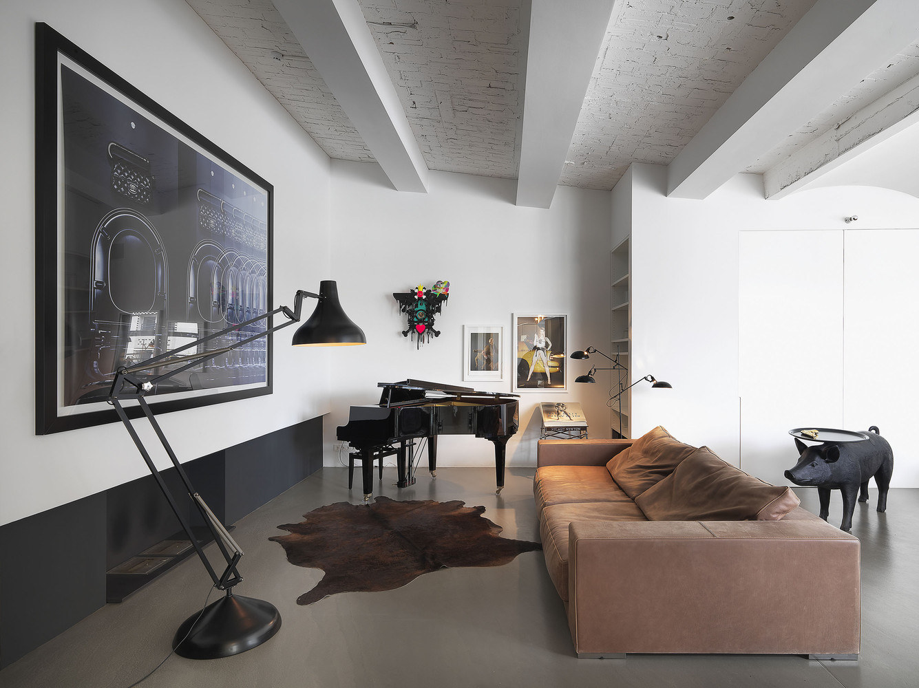 Zoning Living Room's Multiple Functional Areas with Decor and Lighting.  Cow's pelt in the frame of luxurious apartment with combined ceiling
