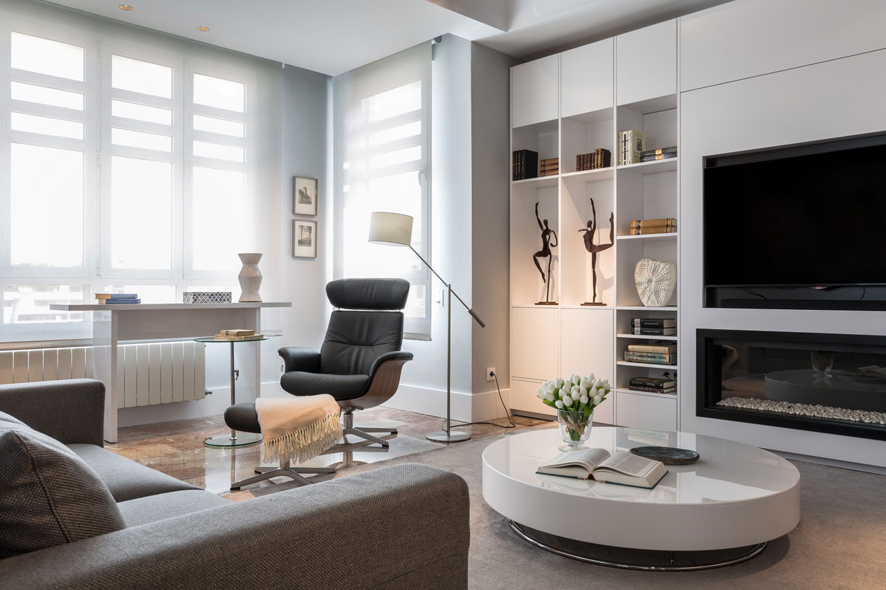 Zoning Living Room's Multiple Functional Areas with Decor and Lighting. Nice though monochromatic ascetic room finishing