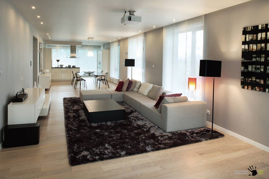 Zoning Living Room's Multiple Functional Areas with Decor and Lighting