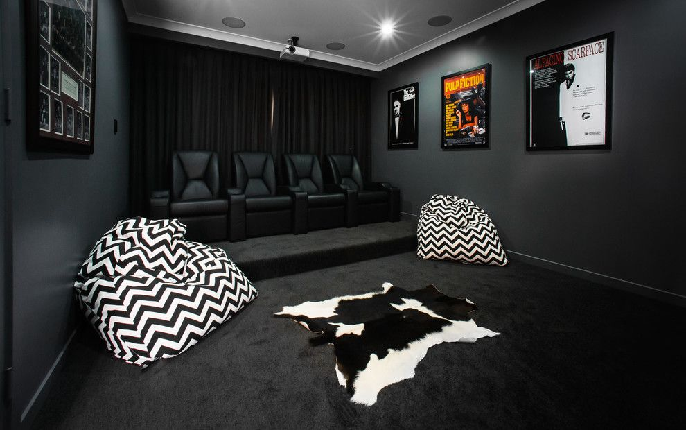 Home Theater as Addition to Large Modern Interior. Noir style with modern hint for the contemporary premise with large leather armchairs