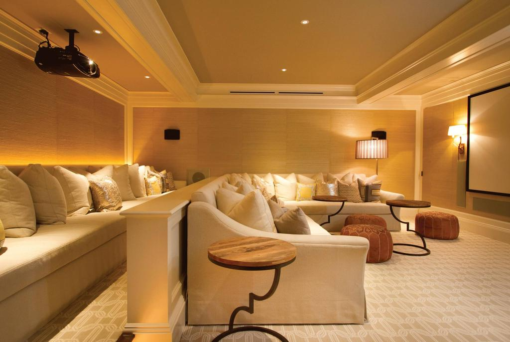 Home Theater as Addition to Large Modern Interior. Minimalistic classic design with the island of the sofa in the center