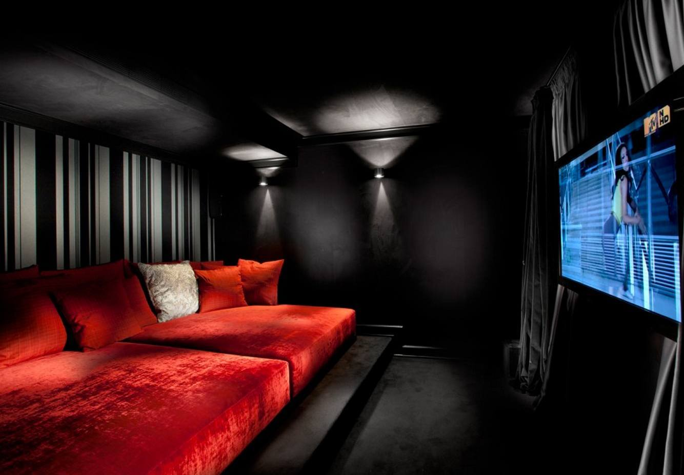 Home Theater as Addition to Large Modern Interior. Intimate dark situation of the really dark neutral design