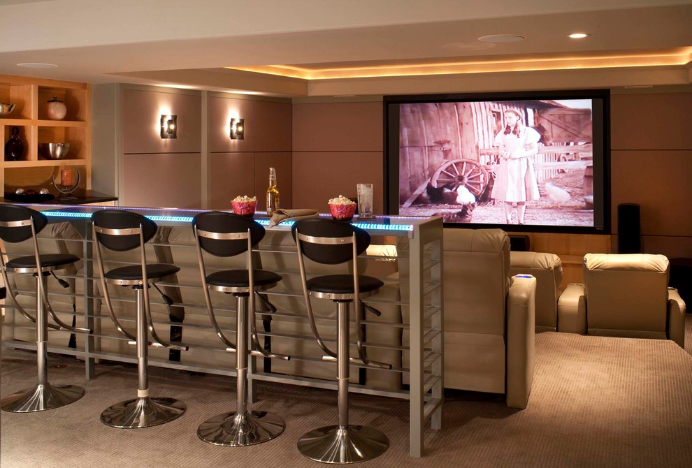 Home Theater as Addition to Large Modern Interior. Bar stools and the bar to have some drinks during watching videos