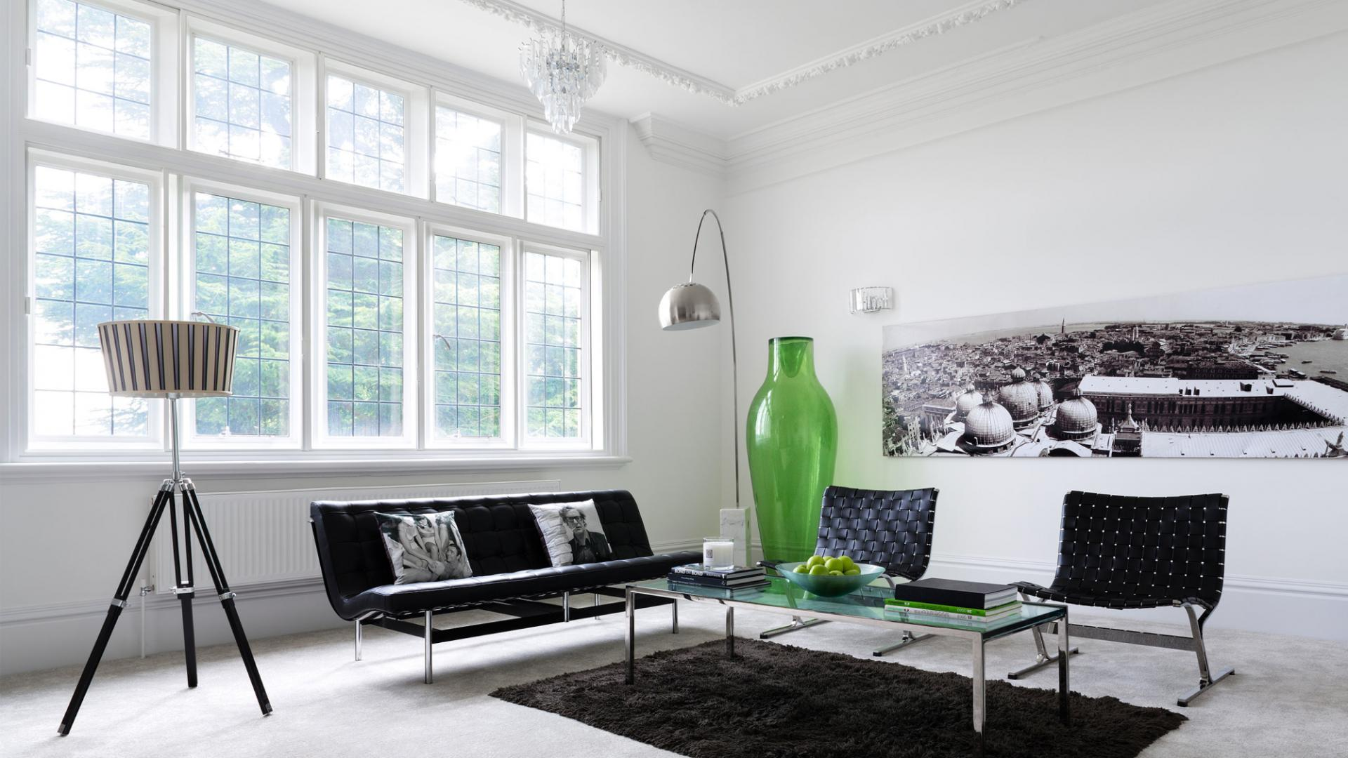 Zoning Living Room's Multiple Functional Areas with Decor and Lighting.  Huge green vase as the decoration in Scandinavian styled living