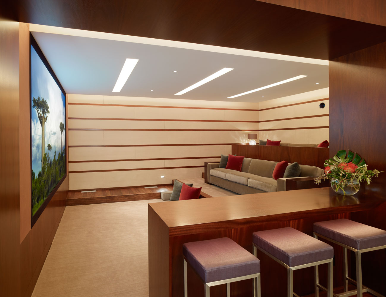 "Home Theater as Addition to Large Modern Interior. Bar and visually ""soft"" walls create an amazing ambiance to watch film"