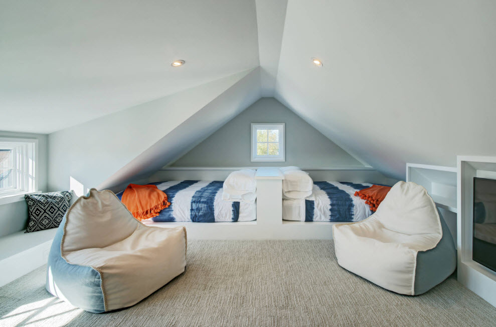 Vaulted ceiling in the loft interior in Marine style with bean bags