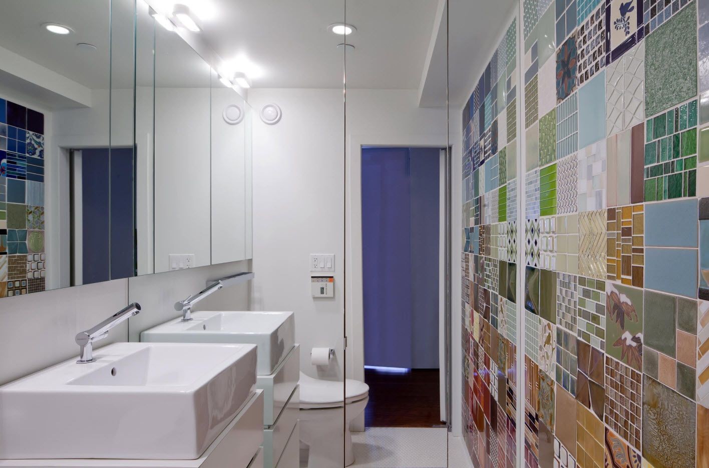 Birght accent wall as a mix of colorful tiles