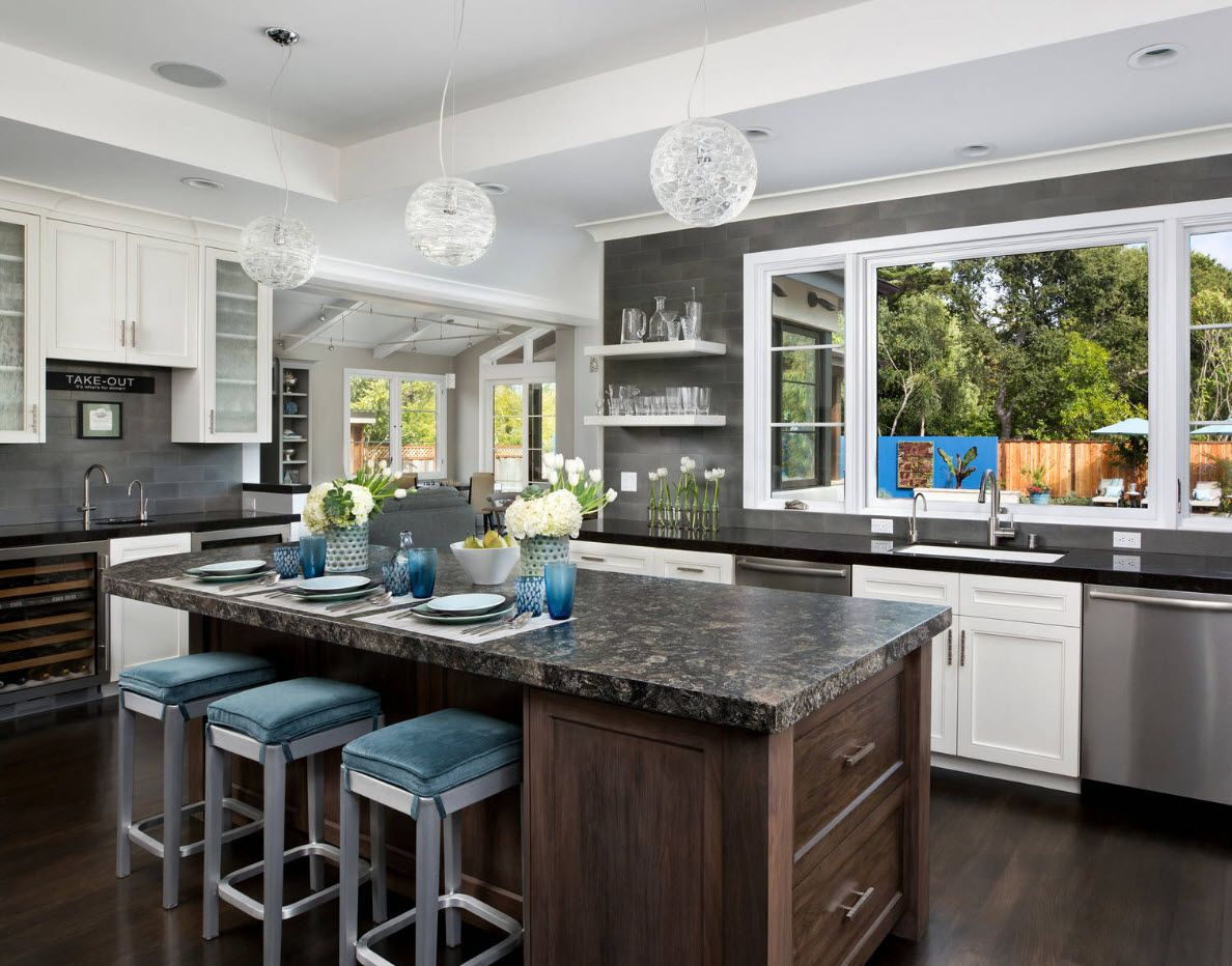 Noble types of the wood in the large spacious and airy interior of the kitchen
