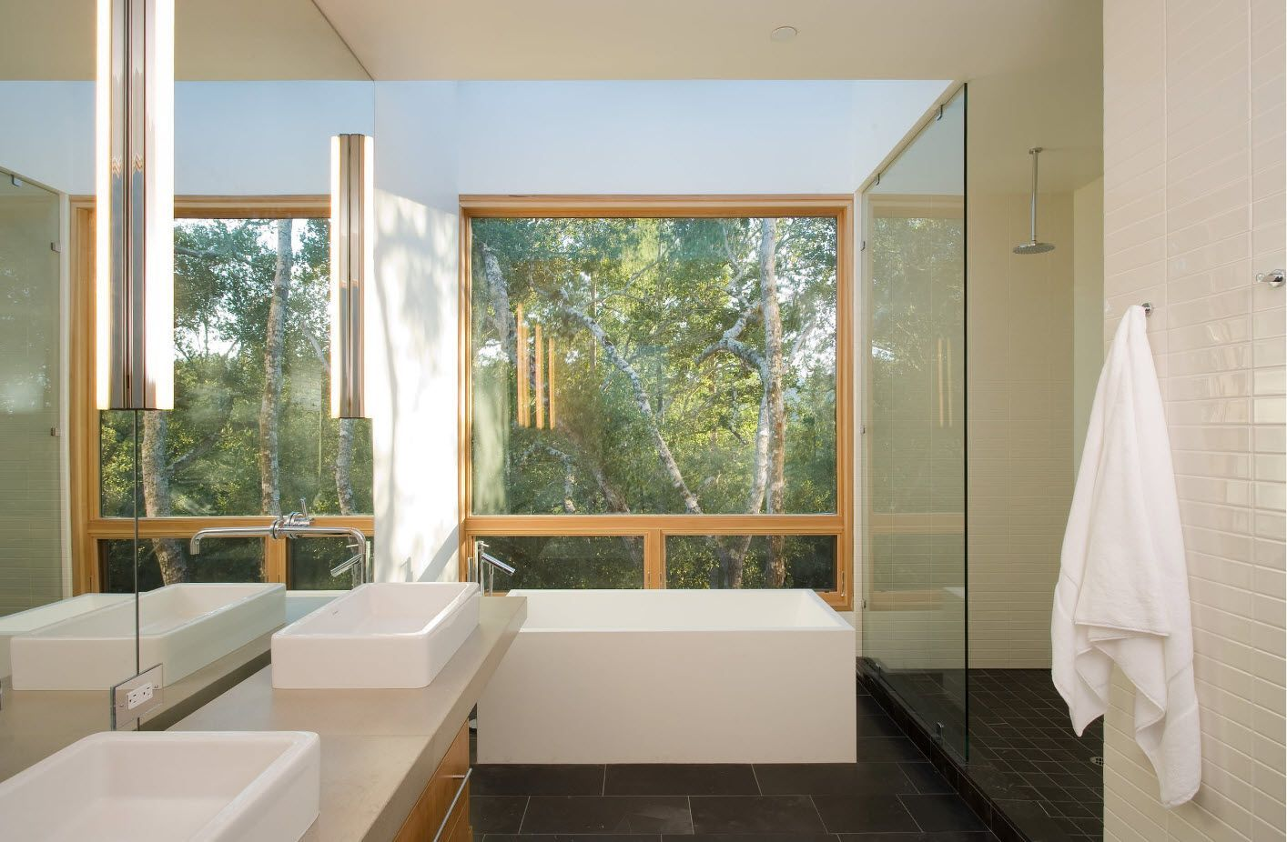 Large window and light finish in the bathroom