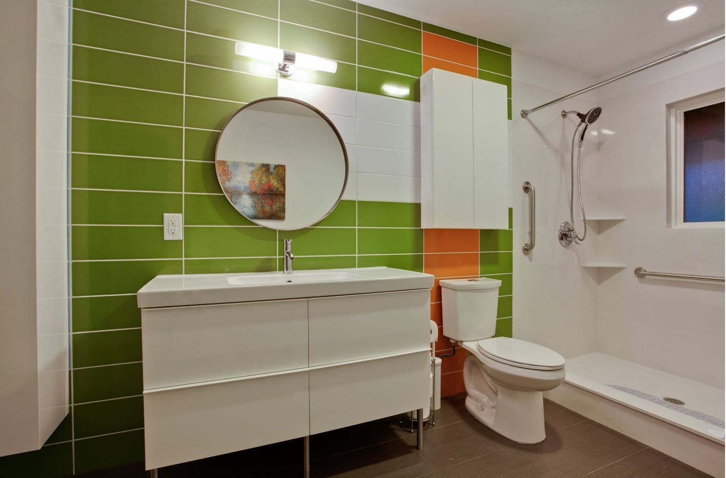 Green accent wall for the bathroom with orange line emphasizing the toilet zone
