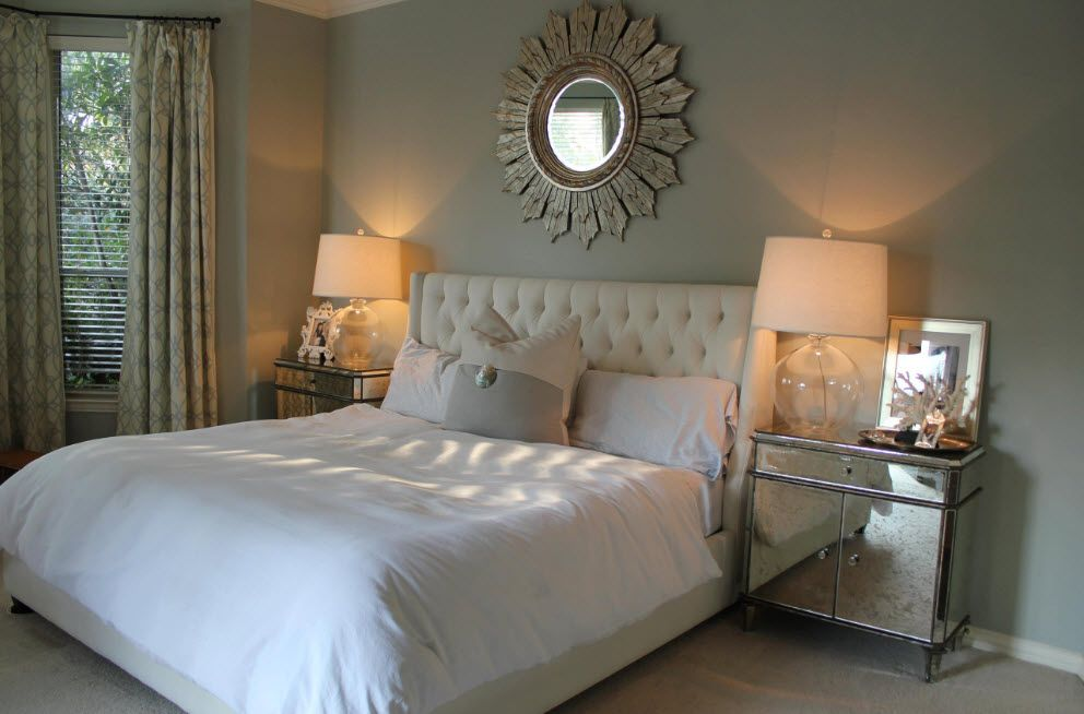 Sun reminiscent mirror frame for luxurious setting of the bedroom in gray color palette