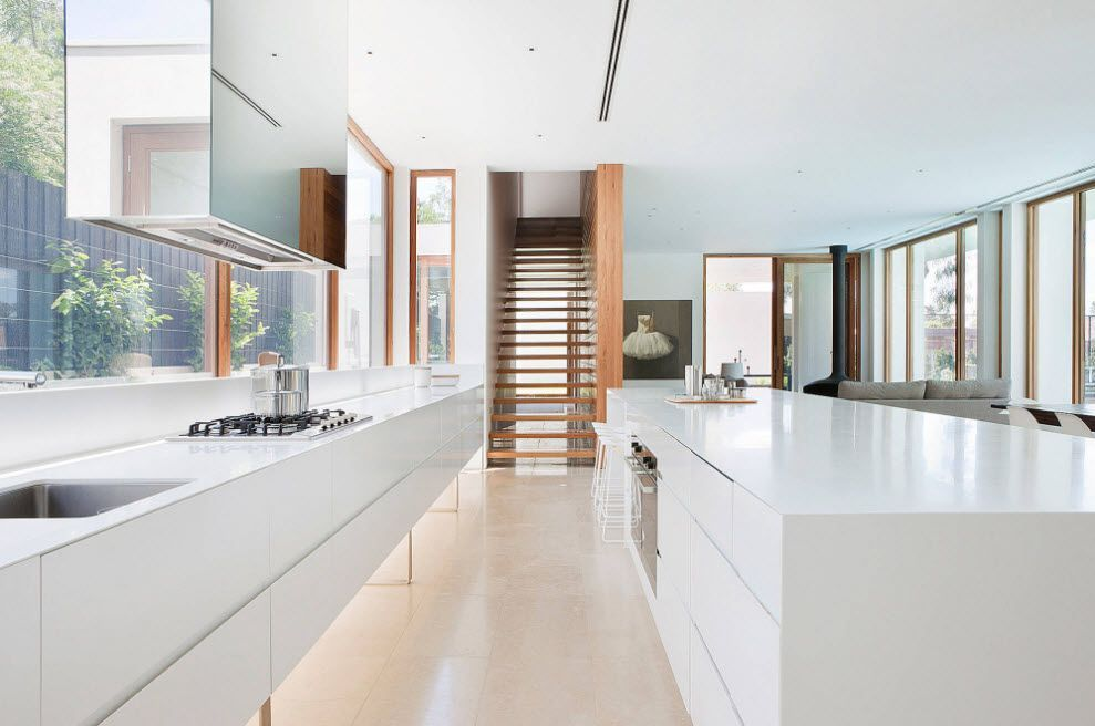 Airy and ultramodern interior of the bathroom with the inlays of the wooden sirfaces