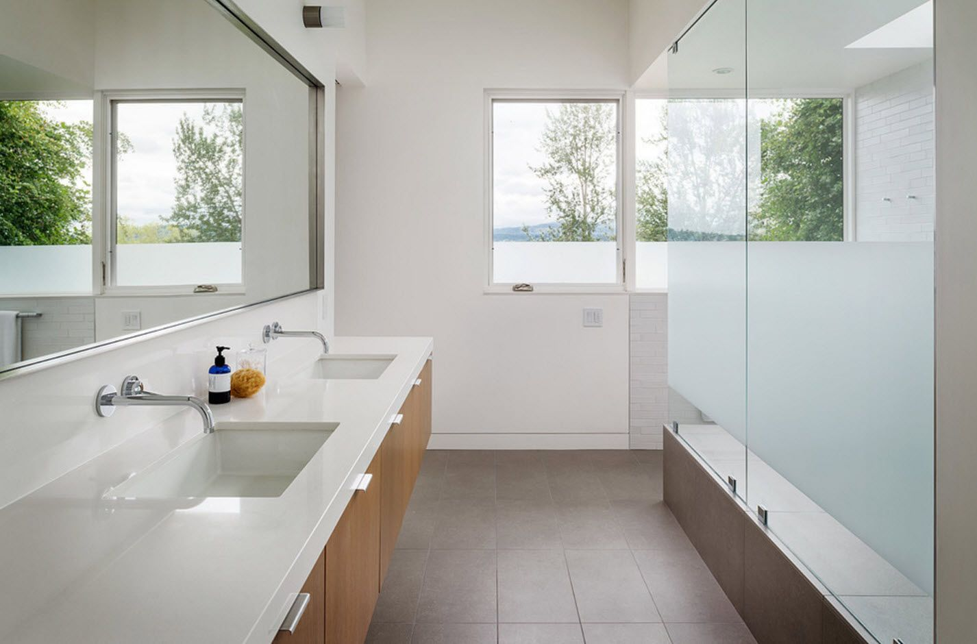 White first floor bathroom for two with wooden vanity facades