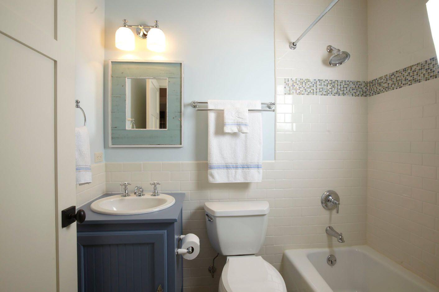 Classic styled bathrrom with dark blue vanity