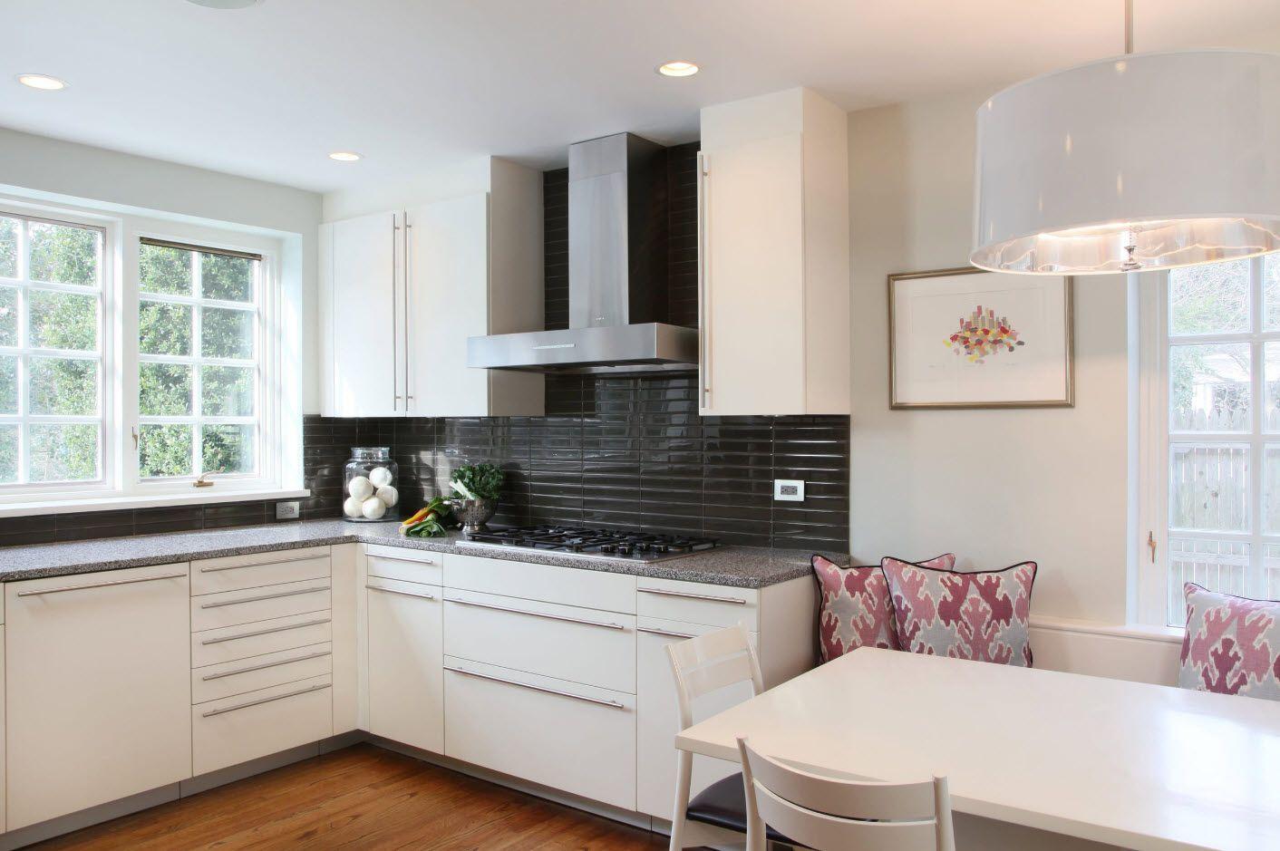 White interior of the kitchen with black tiled backsplash