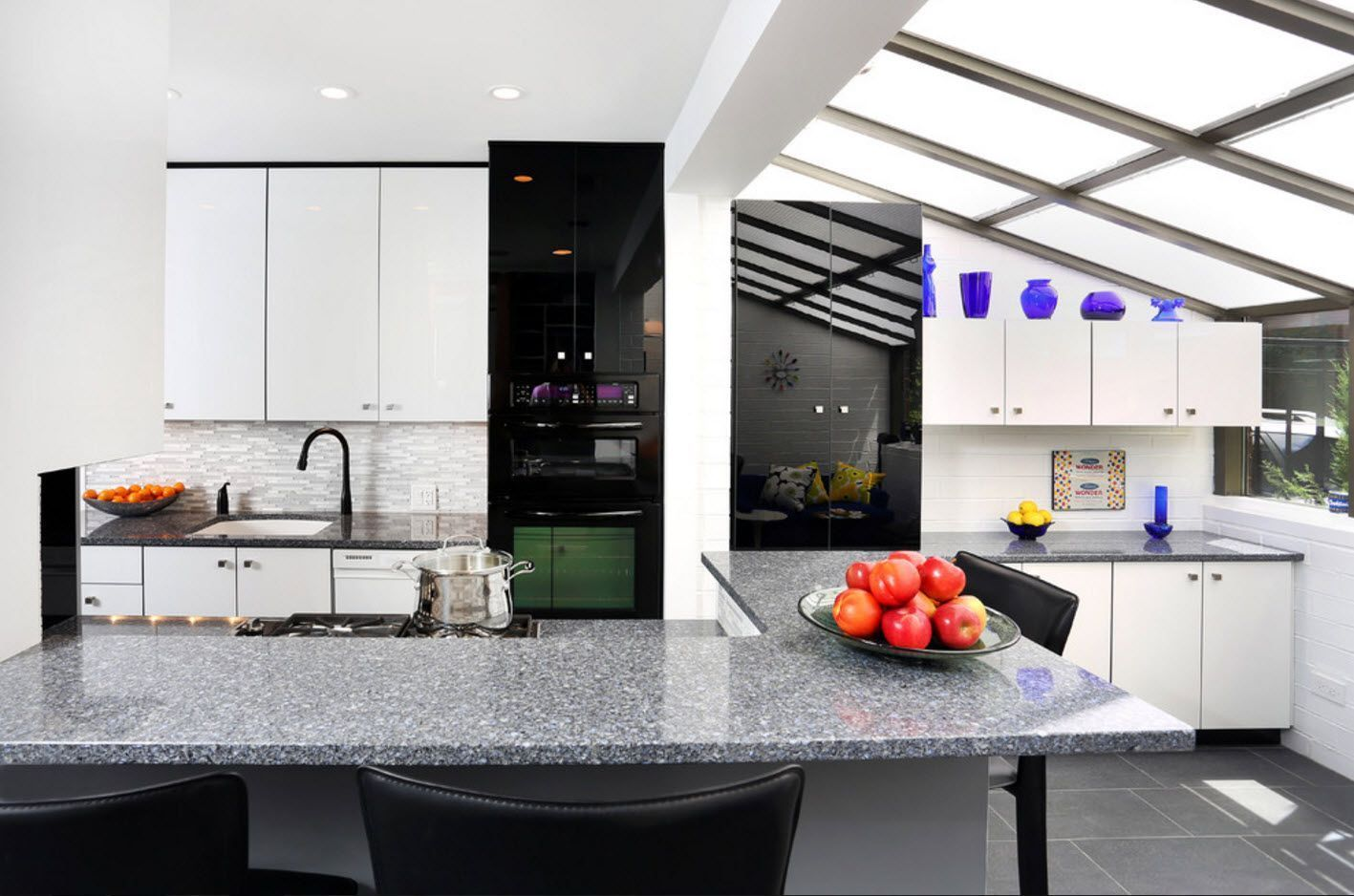 White kitchen and black column of accessories