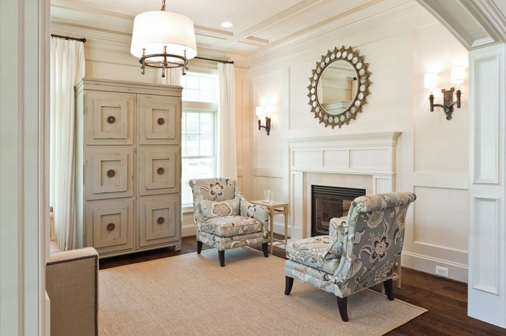 Classic gray finished interior in the private house with hearth and round shaped mirror above it