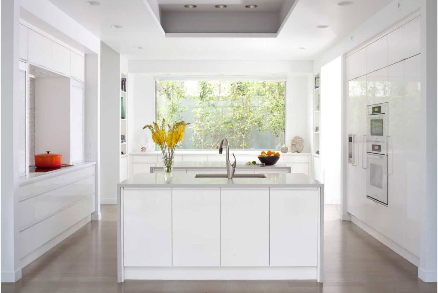 Kitchen Fashion Trends & Interior Design Ideas 2017. White inner atmosphere with the center island and large ceiling extractor hood