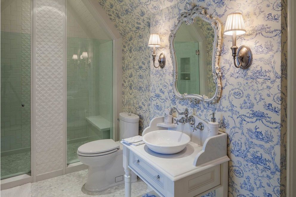 Classic bathrrom interior with chromed tap, round sink and bluish wallpaper pattern