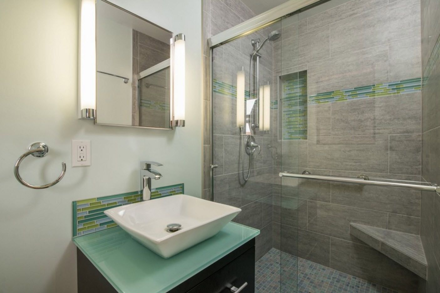 Glass full-height shower cabin and white rest of finishing