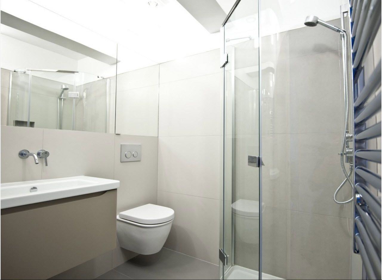 White design in the modern bathroom with built-in toilet