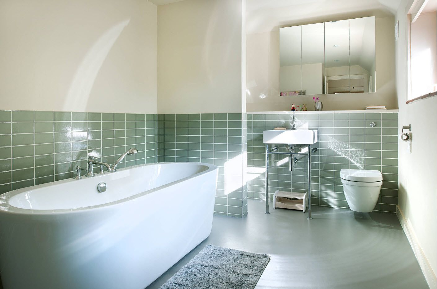 Turquoise metro tile for the lower part of the bathroom in white and light gray palette
