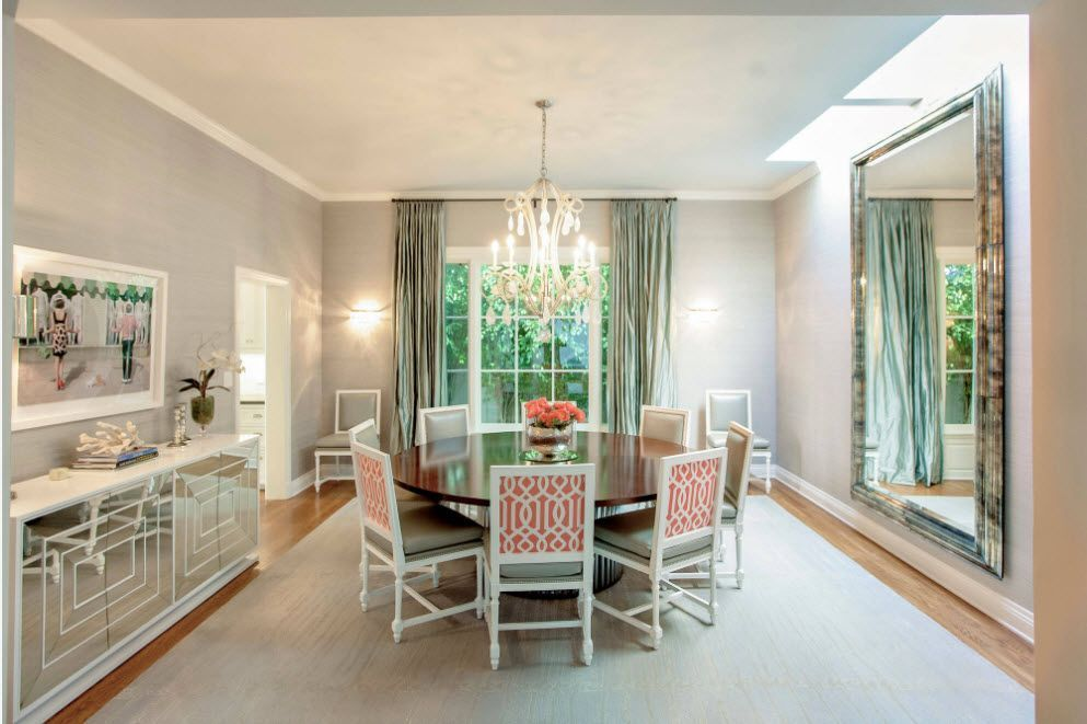 Aesthetically pleasing dining group with enormous mirror and crystal chandelier