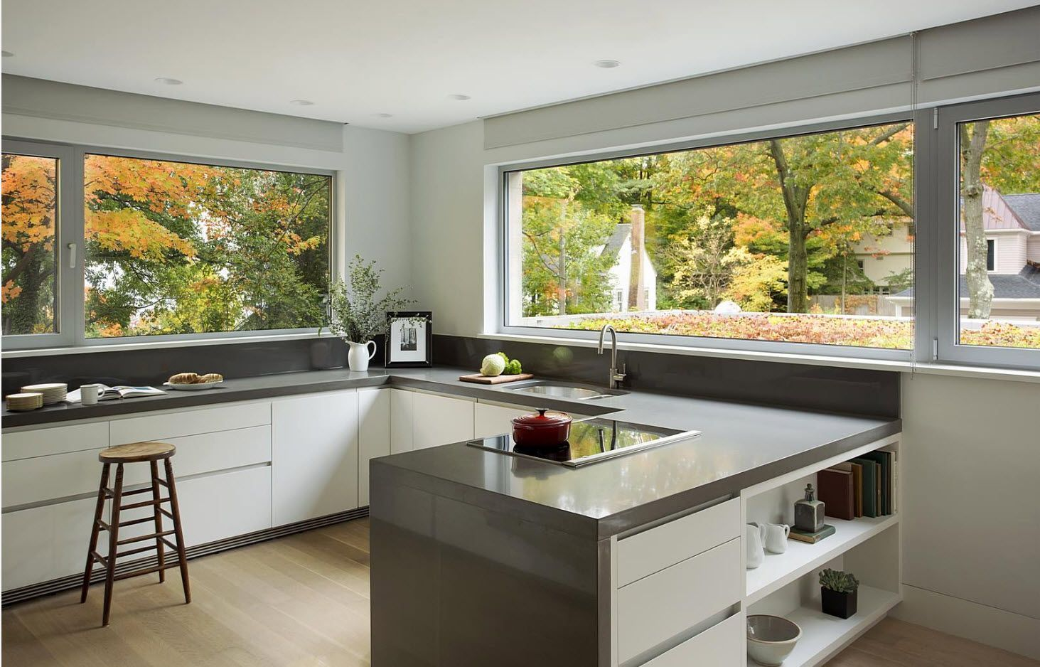 Panoramic windows on each side of the minimalistic kitchen
