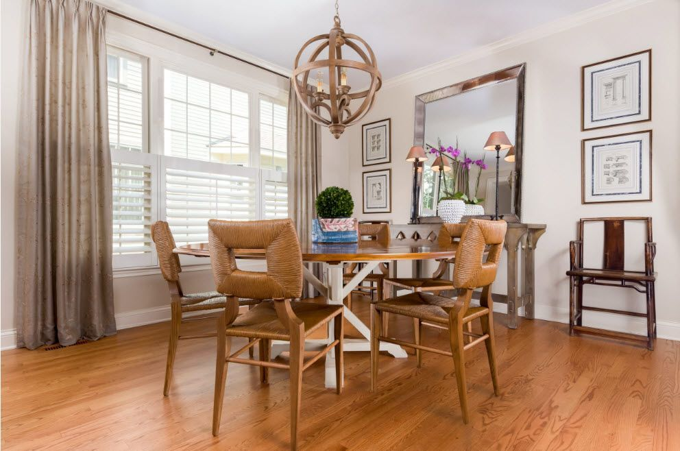 Wooden light lit designed dining room with large window