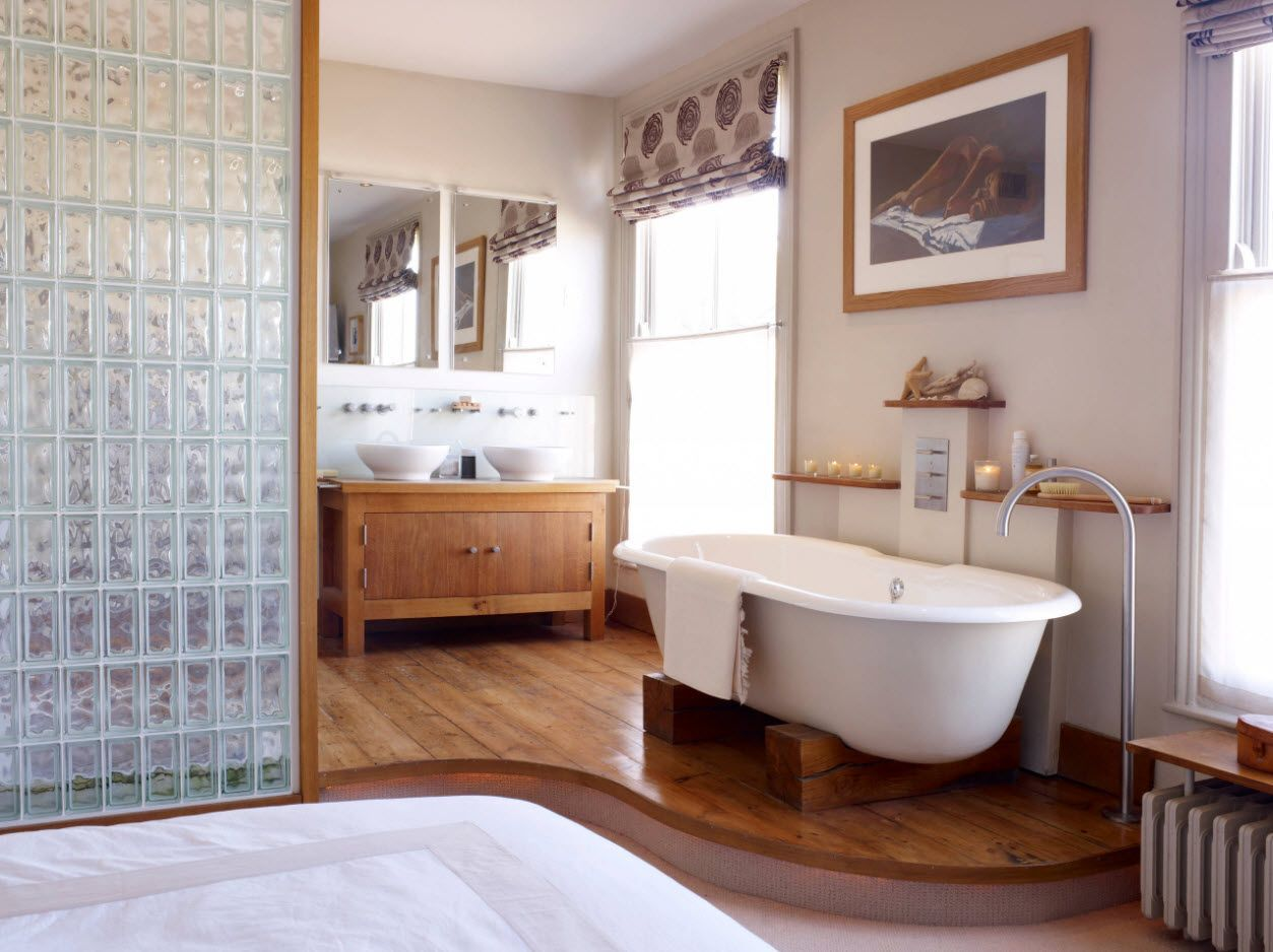 Rounded pedestal of wooden zoned bathtub zone in the Classic decorated bathroom