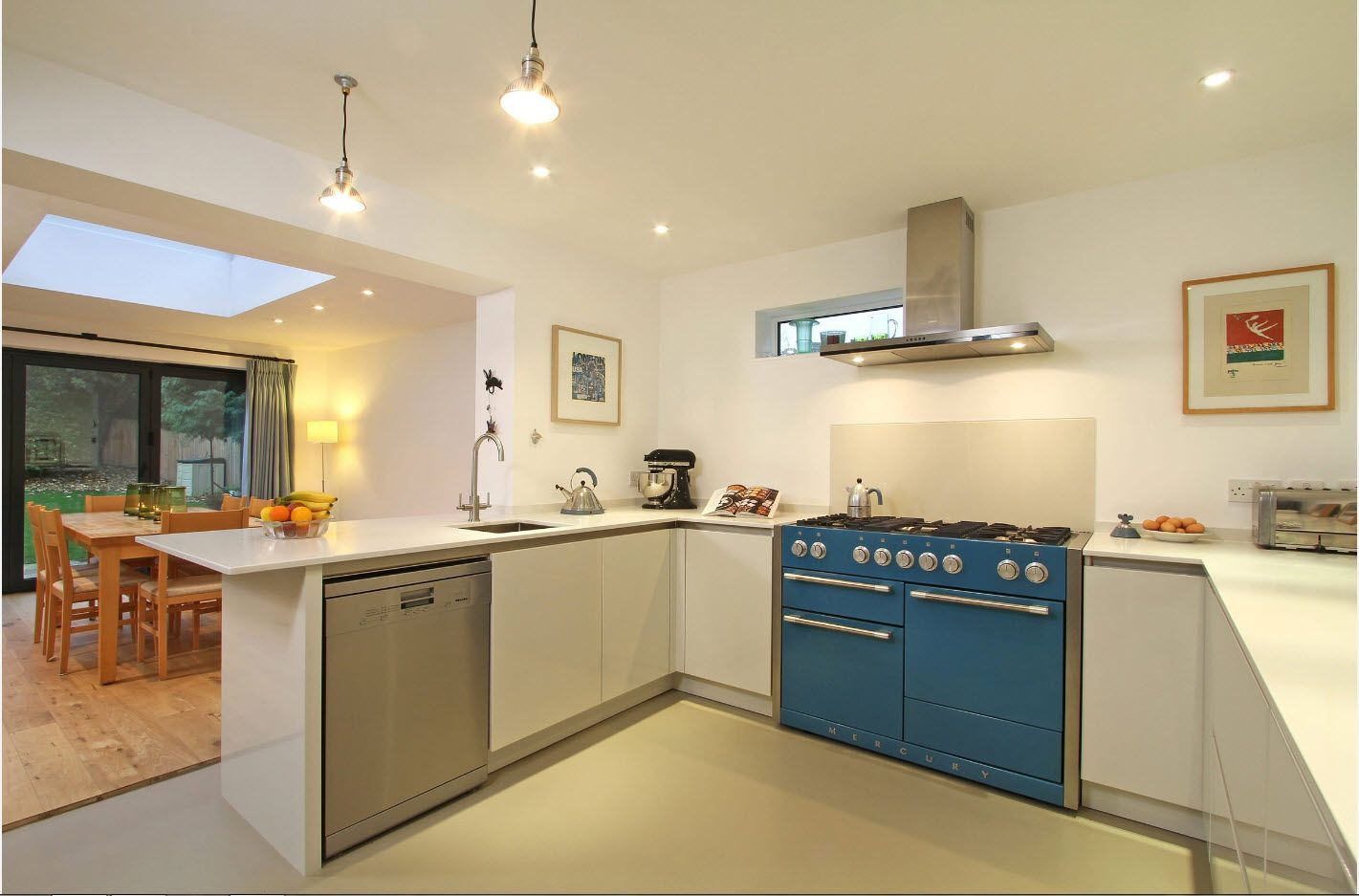 Blue oven and dishwasher as a bright stains in the Classic style interior of the kitchen