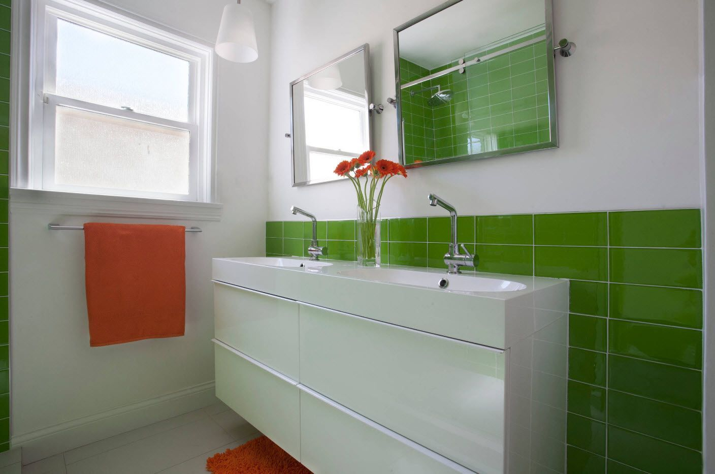 Bright accents of orange and green in the modern bathroom interior 2017