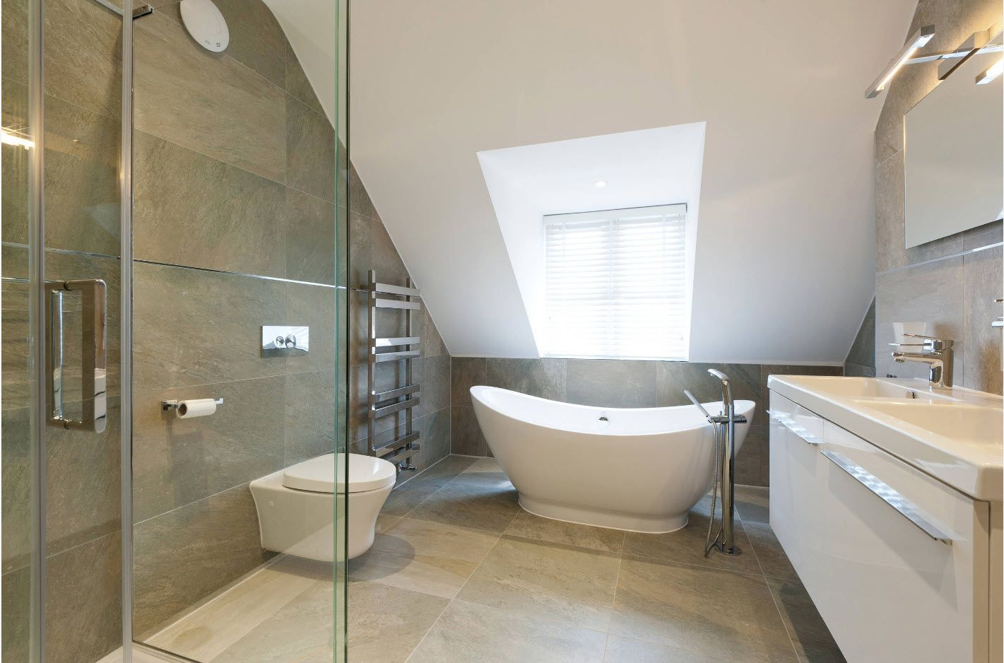 Loft bathroom's spectacular design with large skylight window and gray tiled walls and floor