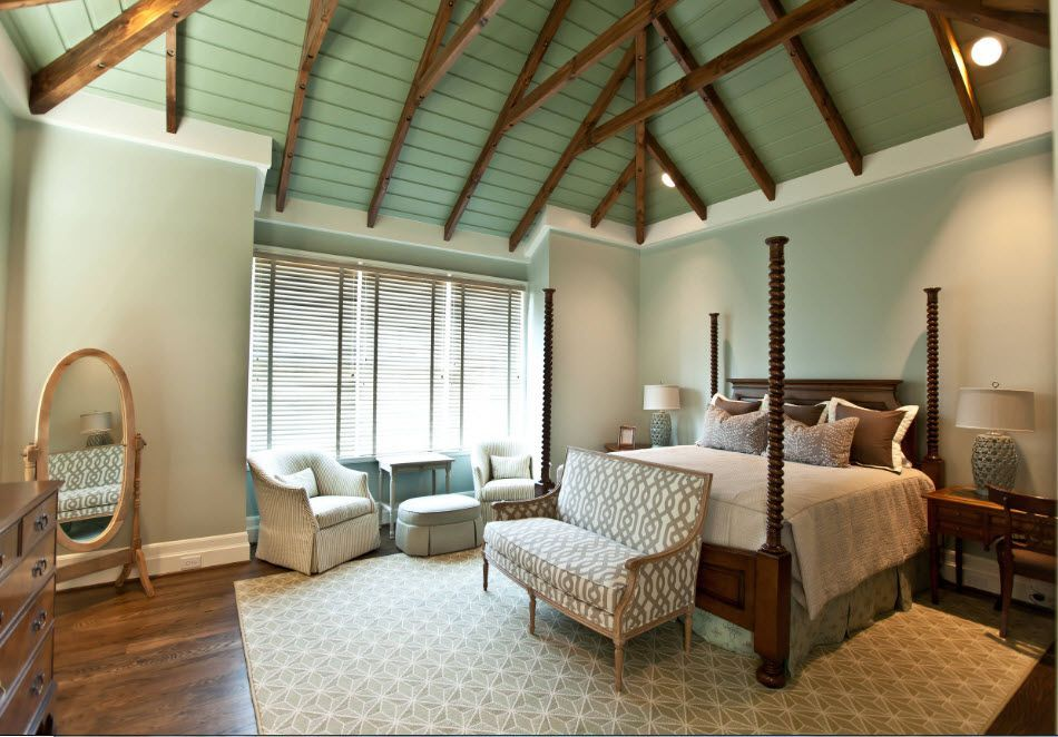 Loft large bedroom with the set of chairs and royal canope bed