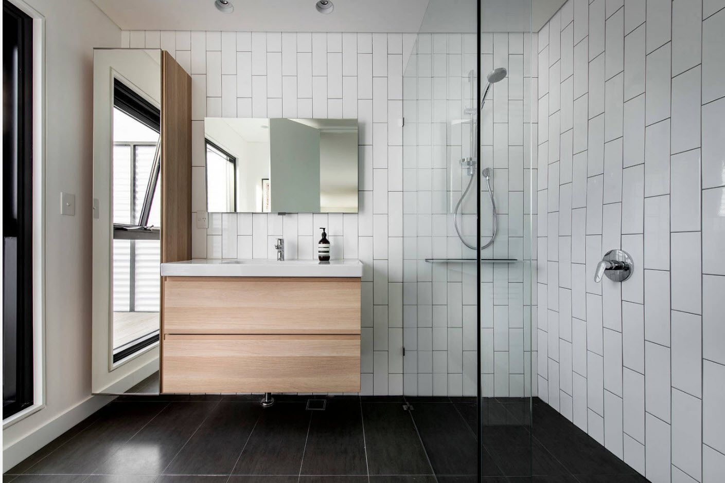 White metro tile on the walls and black stone on the florr