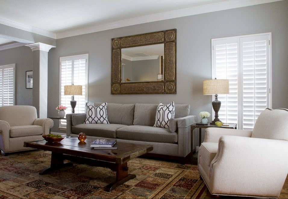 Spectacular mirror in the wooden frame as the accent and focus in the living room