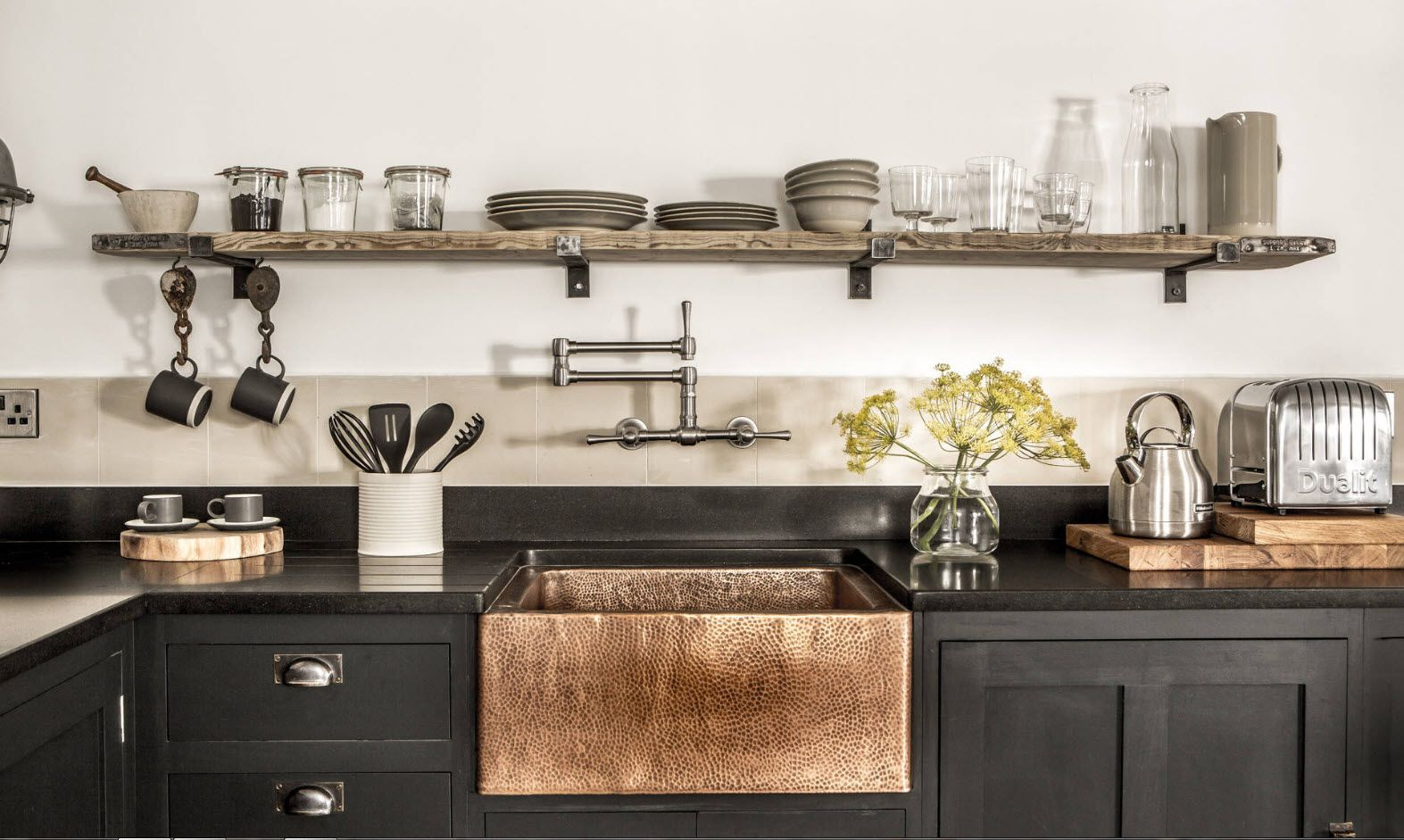 Copper yellow sink within the rustic kitchen design