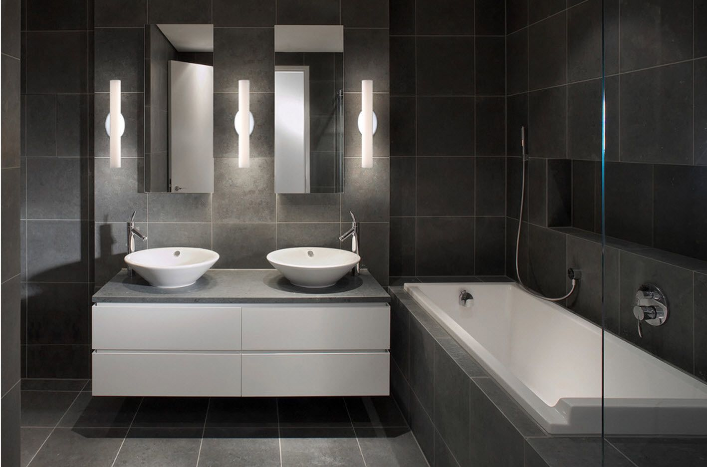 Dark gray marble surfaces in the dull designed bathroom