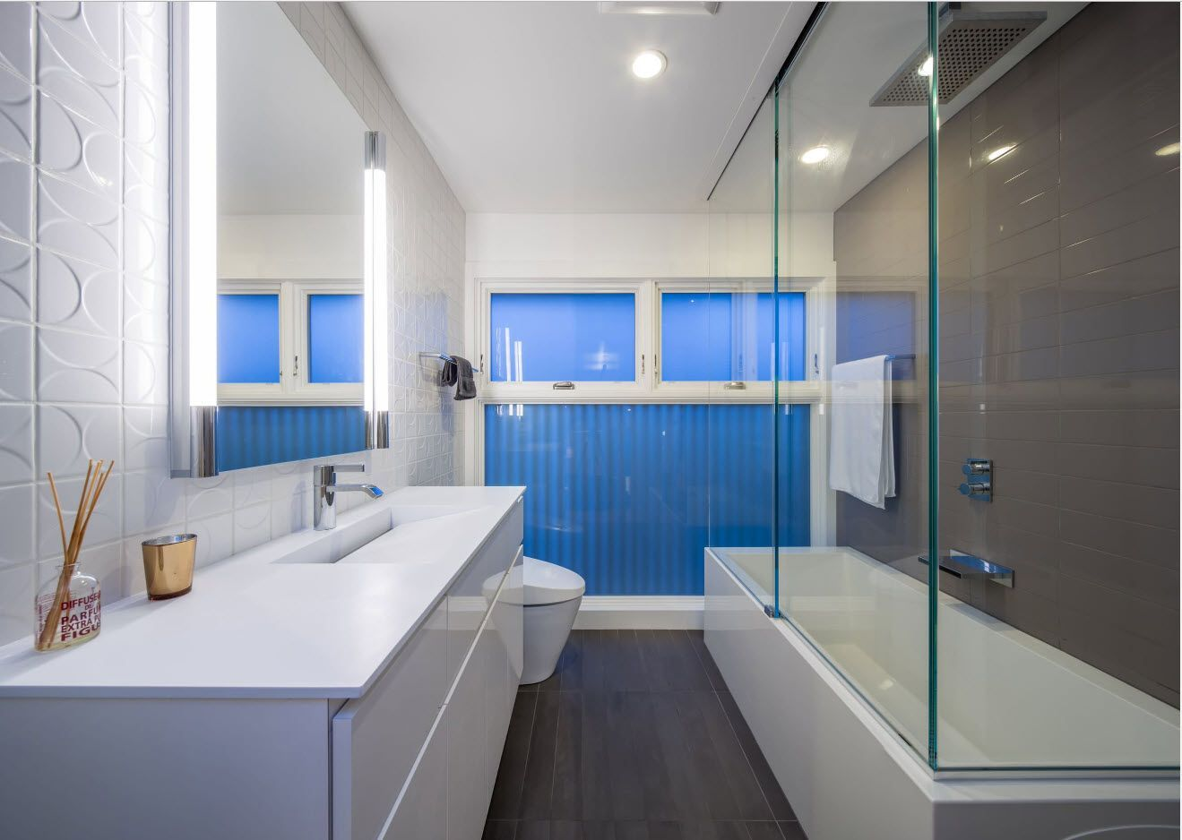 Bright blue accent wall in Modern styled galley bathroom