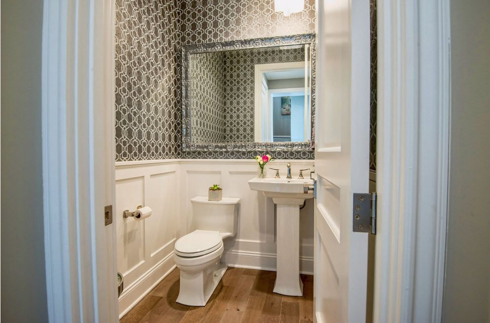 big mirror in the framework of simple designed toilet