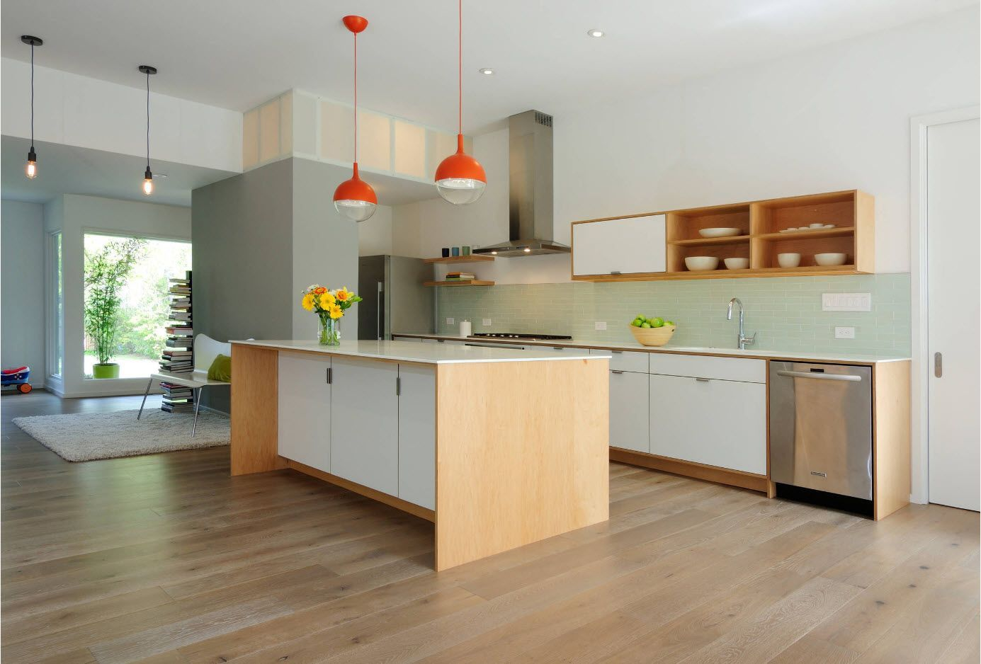 Spcious kitchen and successful design concept with orange lampshades