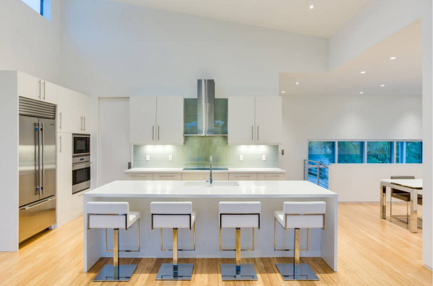 Unusual mUnusual modern and futuristic kitchen interior with the metal framed chairs at the tableodern and futuristic kitchen interior with the metal framed chairs at the dining zone