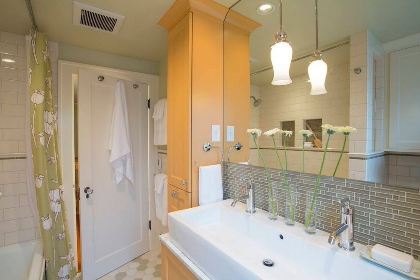 Different zones and combination of materials within bathroom interior