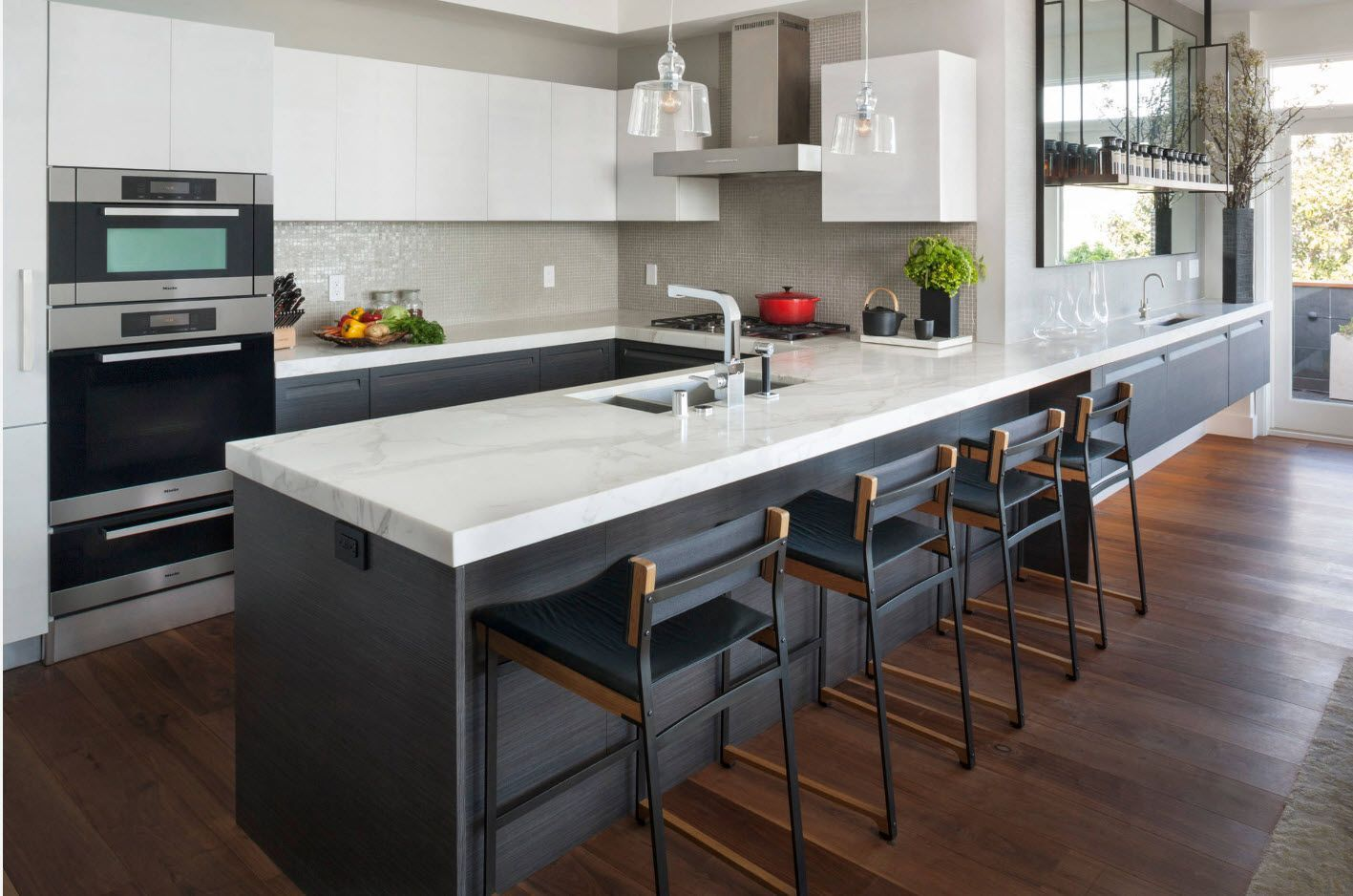 Plane surfaces and strict lines in the absolutely modern hi-tech design of the kitchen