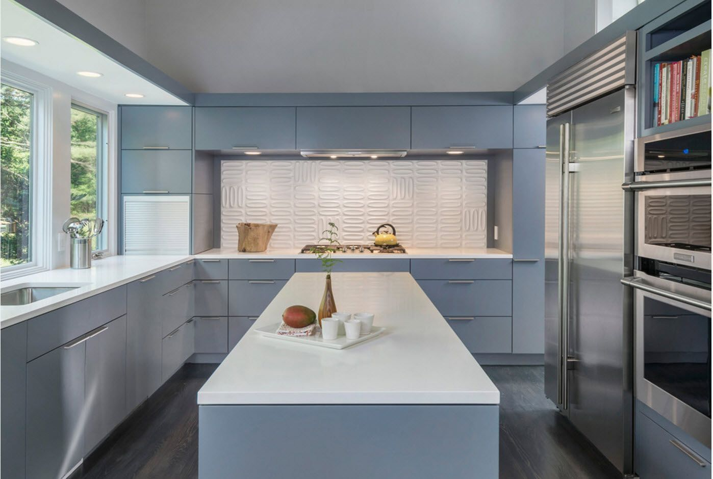 Light blue color scheme for modern and geonetrically right kitchen with island
