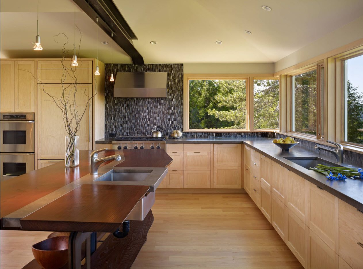 Creamy light brown surfaces of the kitchen set