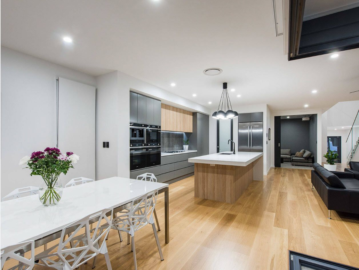 Light wooden floor for the creamy white design of the kitchen