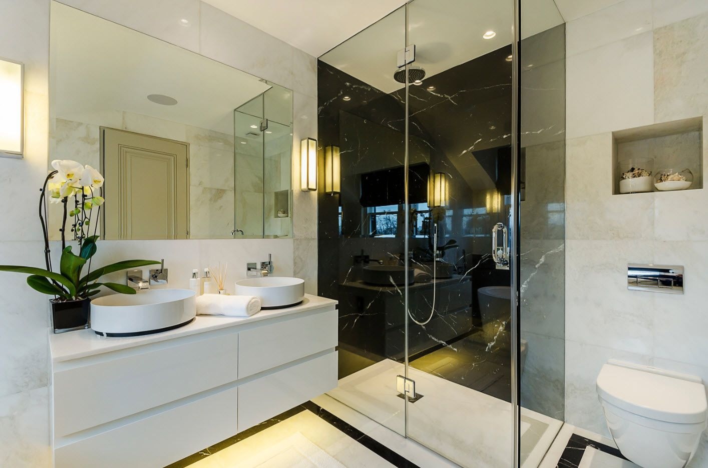 modern top-technology bathroom interior with the accentual shower cabin of glass