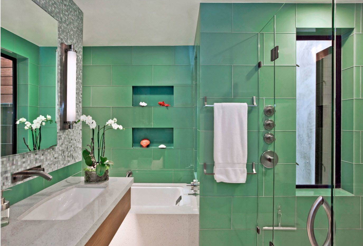 Nice relaxing turquoise wall tile interior finishing for the modern bathroom full of glass surfaces