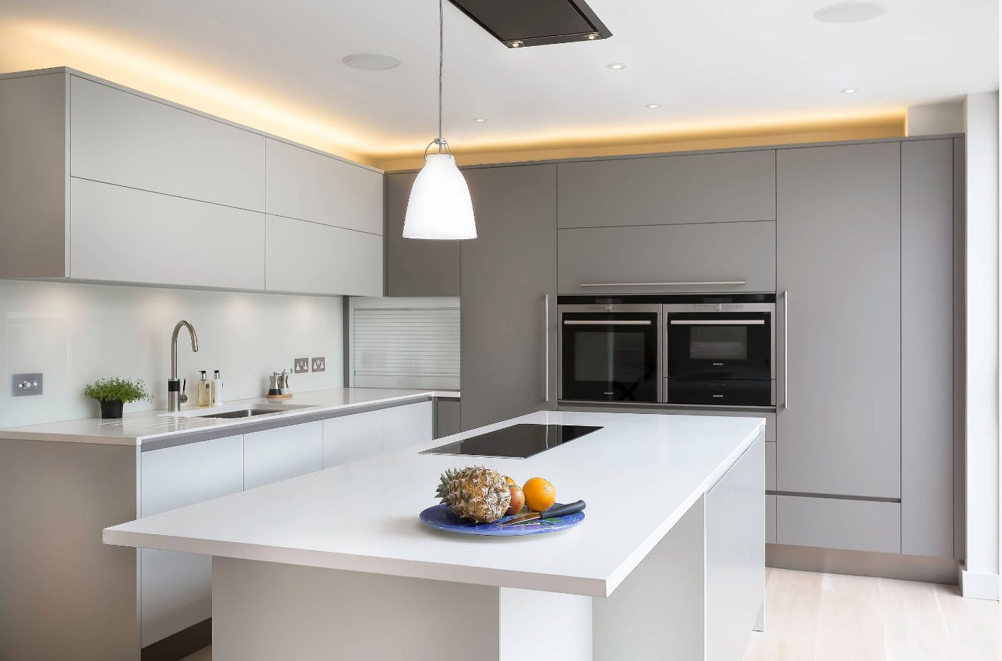gray and white combination of colors on the large kitchen
